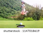 young woman golf player... | Shutterstock . vector #1147018619