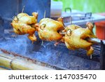 chicken rotates on the grill. | Shutterstock . vector #1147035470