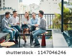 cheerful asian friends sitting... | Shutterstock . vector #1147046246