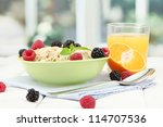 Tasty Oatmeal With Berries And...