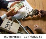 businessmen negotiate  are... | Shutterstock . vector #1147083353