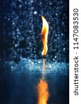 burning match in the water on a ... | Shutterstock . vector #1147083530