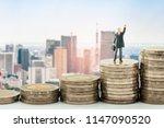 businessman miniature standing... | Shutterstock . vector #1147090520