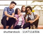 young friends taking a selfie... | Shutterstock . vector #1147116506