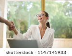 young businesswoman in the... | Shutterstock . vector #1147145933