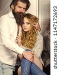 couple in love. woman unbutton... | Shutterstock . vector #1147172693