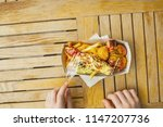 a food hunter holding a tray... | Shutterstock . vector #1147207736
