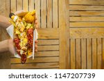 hands with a fork and street... | Shutterstock . vector #1147207739