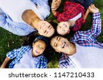 beautiful family relaxed on the ... | Shutterstock . vector #1147210433