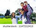 happy three family having fun... | Shutterstock . vector #1147212413