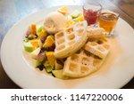 waffles and fruit salad. along... | Shutterstock . vector #1147220006