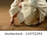 jesus writing on the sand with... | Shutterstock . vector #114722293