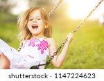 little child girl having fun | Shutterstock . vector #1147224623