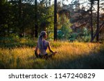 yoga woman meditates in a... | Shutterstock . vector #1147240829