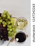 glass of white and red wine on... | Shutterstock . vector #1147242263