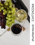 glass of white and red wine on... | Shutterstock . vector #1147242266