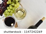 glass of white and red wine on... | Shutterstock . vector #1147242269