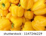 organic yellow bell pepper in... | Shutterstock . vector #1147246229