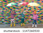 happy children in colorful hats ... | Shutterstock . vector #1147260533