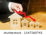 the hand holds a red arrow... | Shutterstock . vector #1147260743