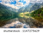 Beautiful alpine lake in the mountains, summer landscape with blue cloudy sky and reflection in crystal clear water, natural background, Morske Oko (Eye of the Sea), Tatra Mountains, Zakopane, Poland
