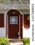 frisian house in germany on 05... | Shutterstock . vector #1147288853