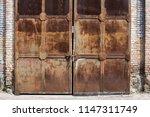 metal doors. rust  old gate.... | Shutterstock . vector #1147311749