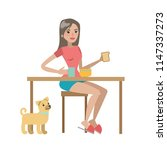 woman having breakfast with dog ... | Shutterstock . vector #1147337273