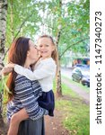 mother and her little daughter... | Shutterstock . vector #1147340273