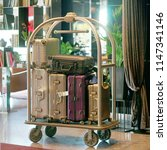 trolley luggage at the hotel.... | Shutterstock . vector #1147341146