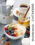cottage cheese for breakfast... | Shutterstock . vector #1147343000