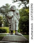 Small photo of WROCLAW, POLAND – JUNE 6 2015: Large caricature sculpture of Socrates with disproportionate big hand. Statue is in a park on Bielarska Island.