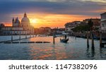 canal with gondolas in venice ...   Shutterstock . vector #1147382096