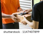 woman hand accepting a delivery ... | Shutterstock . vector #1147407899