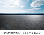 empty asphalt road and blue sea | Shutterstock . vector #1147411619