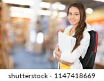 cute young student girl with... | Shutterstock . vector #1147418669