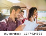 mixed group of happy young... | Shutterstock . vector #1147424936
