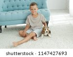 child with dog  | Shutterstock . vector #1147427693