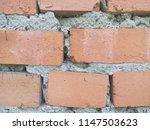 an old brick wall. ancient... | Shutterstock . vector #1147503623