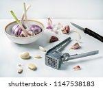 press for squeezing garlic lies ... | Shutterstock . vector #1147538183