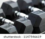 rows of black metal dumbbell...   Shutterstock . vector #1147546619