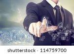 businessman touching a graph...   Shutterstock . vector #114759700