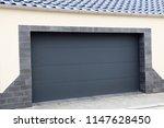 modern new garage door ... | Shutterstock . vector #1147628450