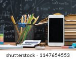 school books and stationery on... | Shutterstock . vector #1147654553