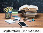 school books and stationery on... | Shutterstock . vector #1147654556
