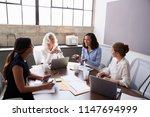 four businesswomen in... | Shutterstock . vector #1147694999