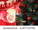 girl holding a cappuccino cup.... | Shutterstock . vector #1147714790
