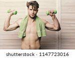 athlete with naked torso after... | Shutterstock . vector #1147723016