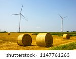 scenic wind turbine with hay... | Shutterstock . vector #1147761263