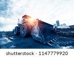 yellow excavator on new... | Shutterstock . vector #1147779920